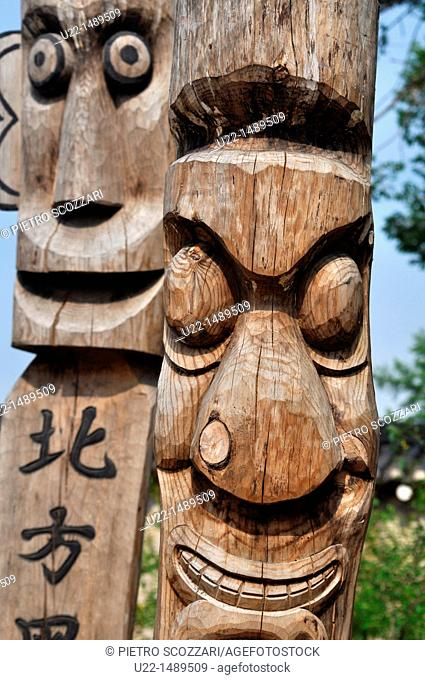 Seoul (South Korea): wooden statues by the National Folk Museum; usually put at the entrance of a village or on the roadside
