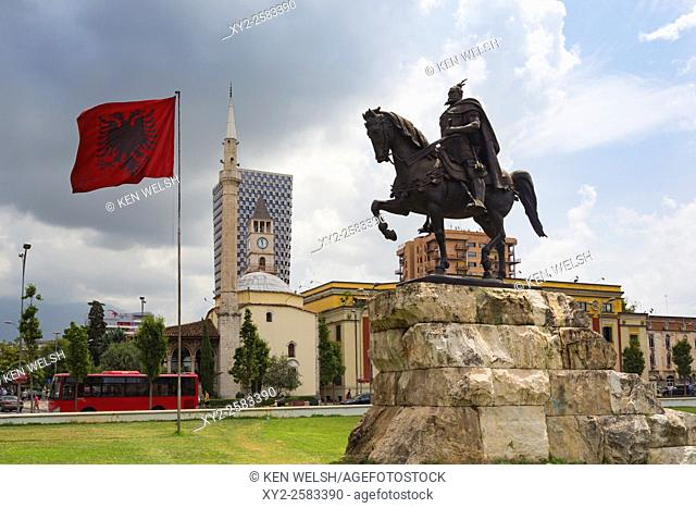"Tirana, Albania. Skanderbeg Square with monument to Skanderbeg, real name George Castriot, 1405 â. "" 1468. Albanian national flag"
