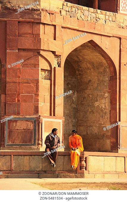 Indian couple sitting at Humayuns private library, Purana Qila, New Delhi, India