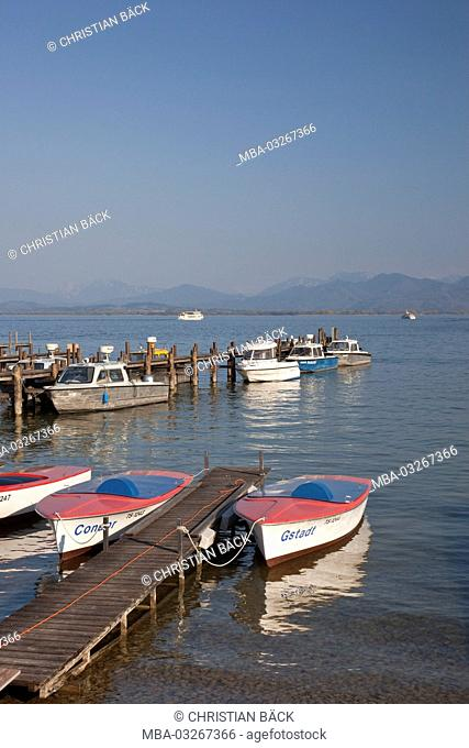 Row boats in Chiemsee, Chiemgau, Gstadt in Chiemsee, Upper Bavaria, Bavaria, South Germany, Germany