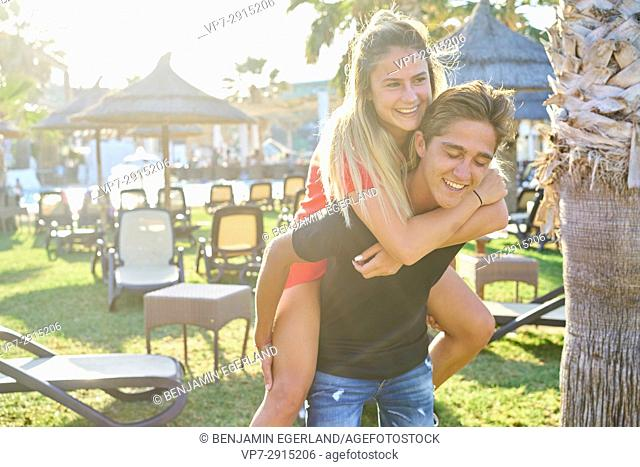 vibrant young Dutch couple having fun together outdoors in the holiday destination Hersonissos, Crete, Greece