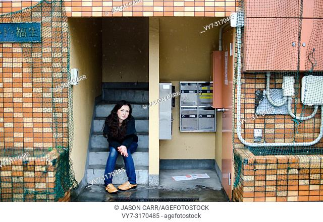 Japanese Girl poses on the street in Fussa, Japan. Fussa is a city located in Tokyo