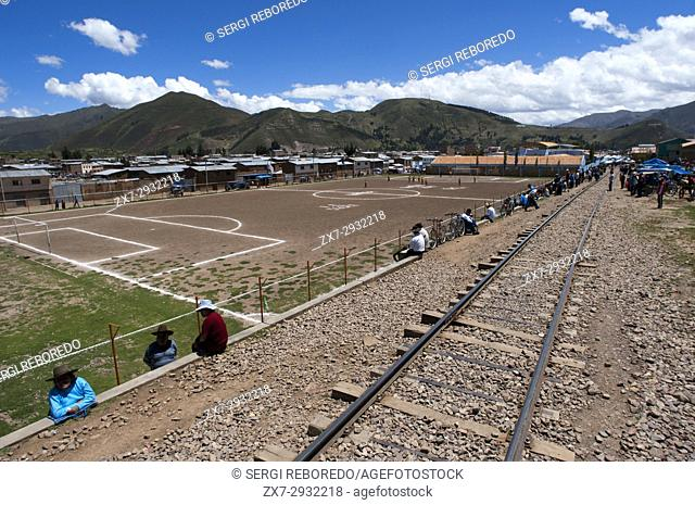 Sicuani city, Cusco, Peru. Railway tracks. Peruvian altiplano landscape seen from inside the Andean Explorer train Orient Express which runs between Cuzco and...