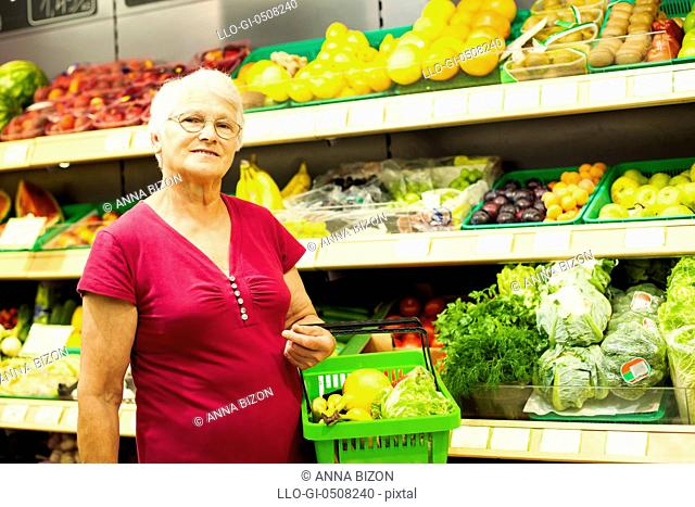 Portrait of senior woman at supermarket Debica, Poland