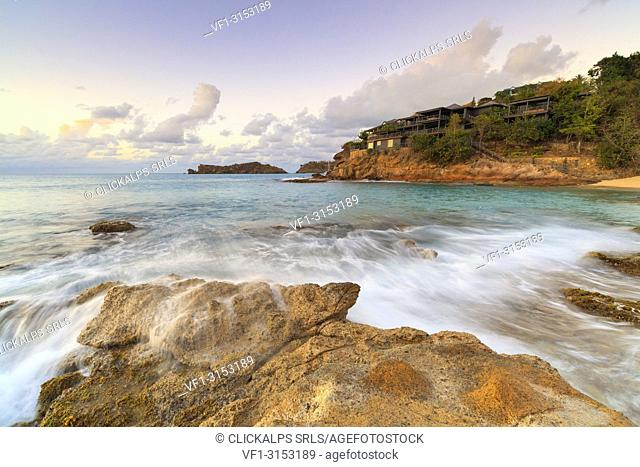 Sunset on waves of the rough sea, Galley Bay Beach, Antigua, Antigua and Barbuda, Caribbean, Leeward Islands, West Indies