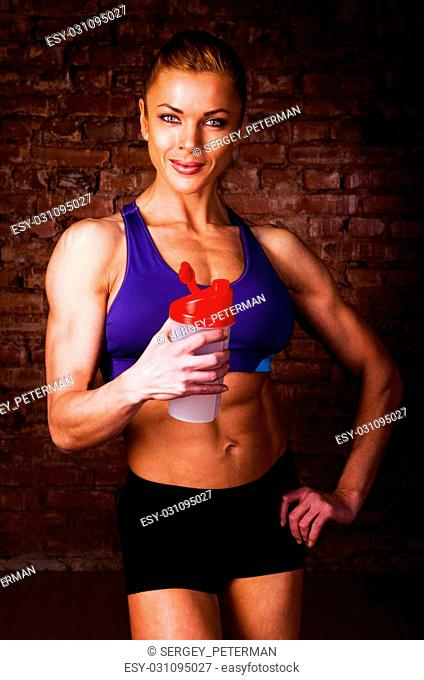 strong woman with sports nutrition