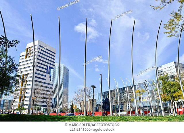 Futuristic Sculpture, green grass, buildings, blue sky. Plaça Europa, Plaza Europa, District VII, Gran Via, Hospitalet de Llobregat, Barcelona province