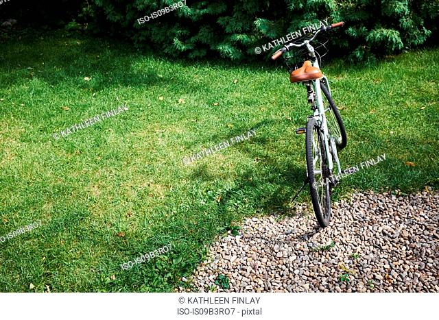 Bicycle parked on garden lawn