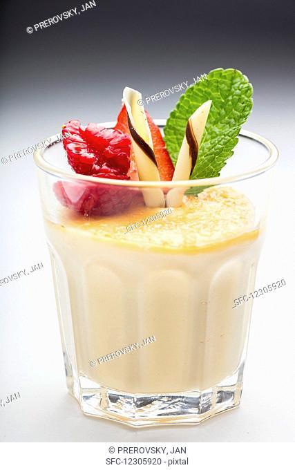 White chocolate cream with raspberries and mint