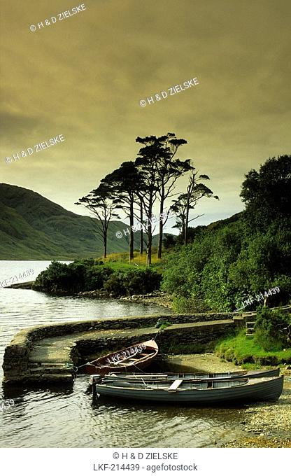 Boats at a jetty at Doo Lough, Connemara, County Mayo, Ireland, Europe