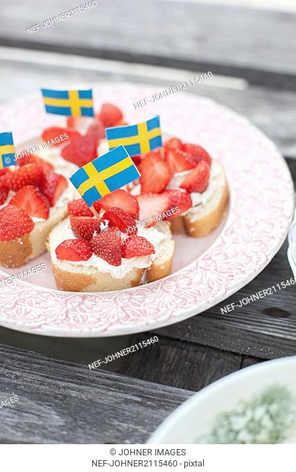 Strawberries on bread with Swedish flag