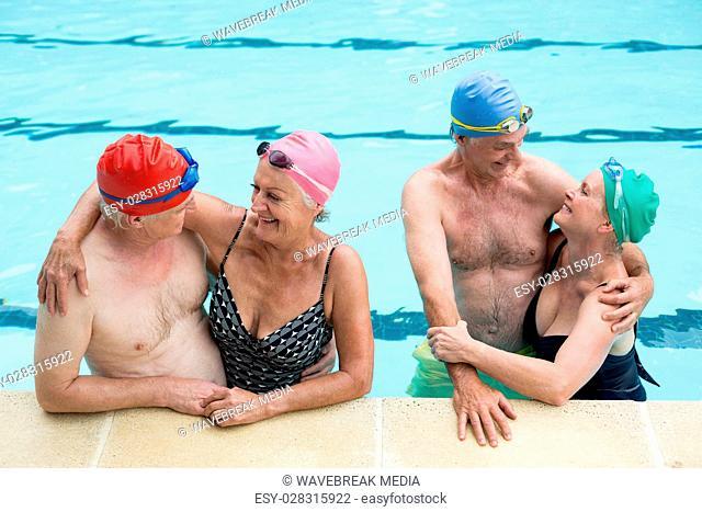 Happy senior couples enjoying in pool