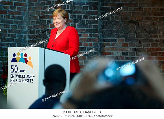 12 July 2019, Berlin: Federal Chancellor Angela Merkel (CDU) speaks to the invited development workers during a ceremony marking the 50th anniversary of the...