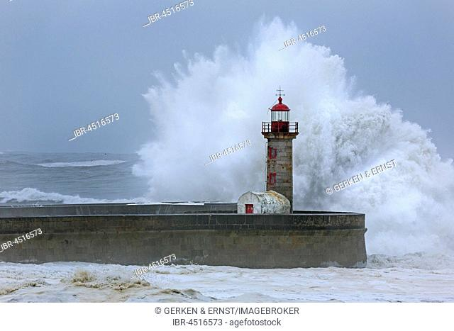 High waves, splashing spray, lighthouse during storm, Porto, Portugal