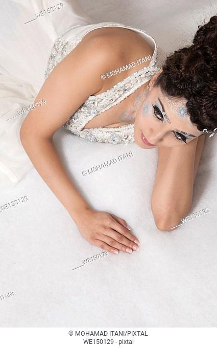 Beautiful woman laying down looking away