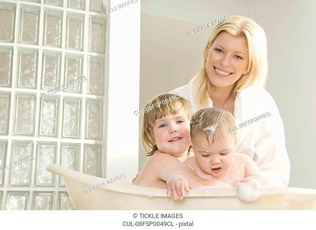 A mum bathing her babies