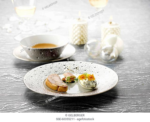 Pan-fried foie gras,whipped cream with seaweed and flowers,raw haddock