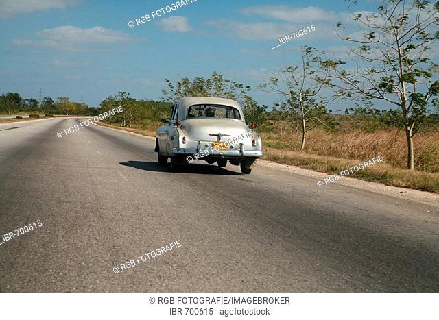 Vintage car driving along the autopista from Vinales to Havana, Cuba, Caribbean, Americas