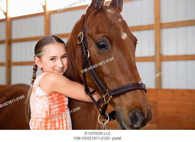 USA, Illinois, Metamora, Portrait of girl 10-11 embracing horse