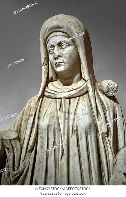 Roman statue of a priestess. Marble. Perge. 2nd century AD. Inv no 2015/192. Antalya Archaeology Museum; Turkey. Against a grey background
