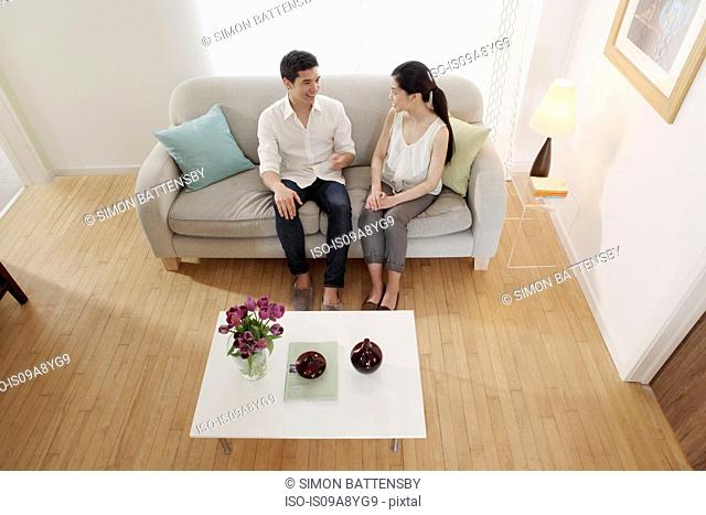 Couple chatting in living room