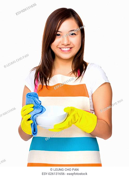 Young housewife washing dishes