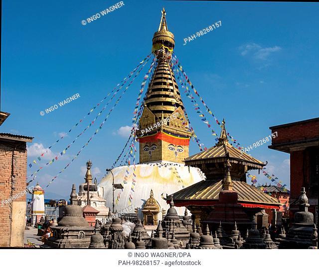 The Stupa of Swayambhunath, known as the monkey temple, on a hill in the Nepalese capital Kathmandu. | usage worldwide. - Kathmandu/Nepal