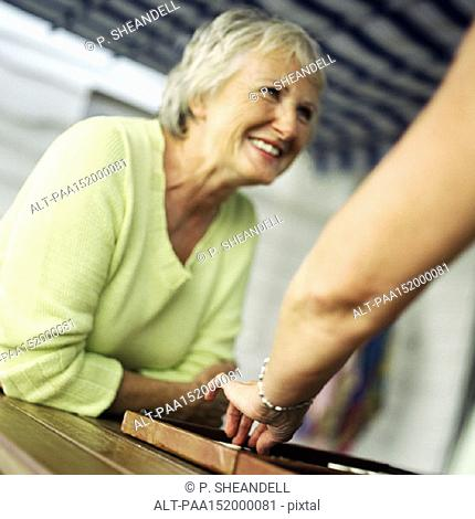 Mature woman sitting, playing backgammon, portrait