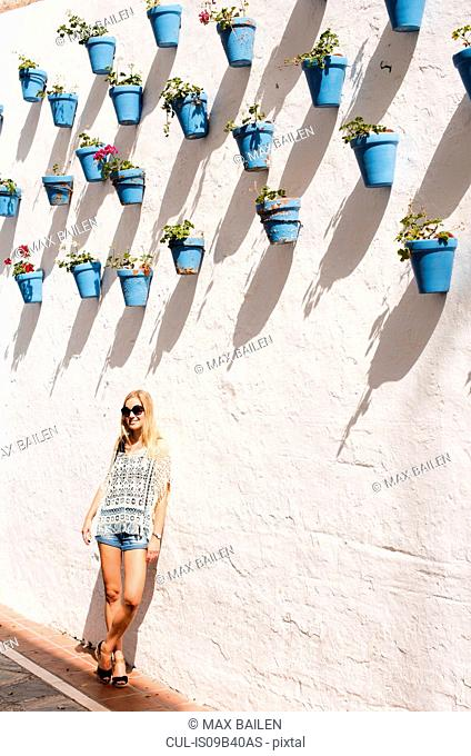 Woman leaning against wall, Marbella old town, Spain