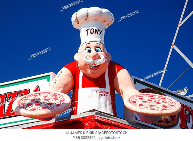 A cartoonish pizza maker lures hungry customers with its larger than life sign