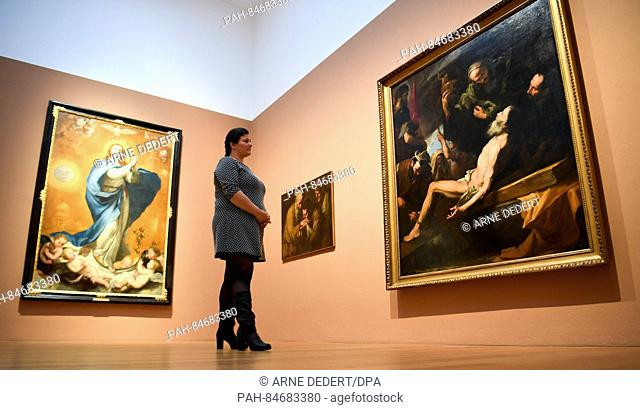 """The curator Rebecca Krämer looks at the paintings """"""""The immaculate conception of Maria"""""""" (L), 1612-1613 and """"""""The martyrdom of Saint Andrew"""""""" (R)"""