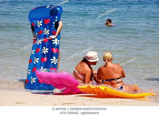 Women at the beach with air mattress, palma de mallorca