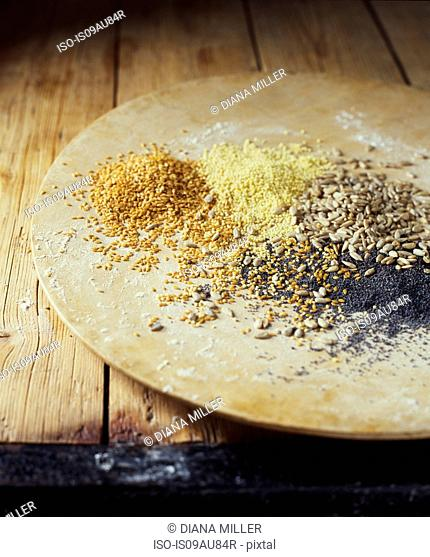 Organic bakery ingredients, plate with mix of poppy sunflower and flax seeds