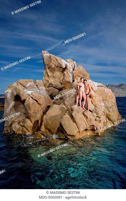 The swimmers Federica Pellegrini and Filippo Magnini on the rocks of the promontory of Capo Coda Cavallo. Olbia-Tempio, Italy. 15th August 2015