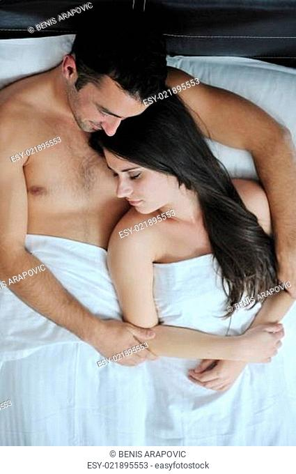 young couple have good time in their bedroom