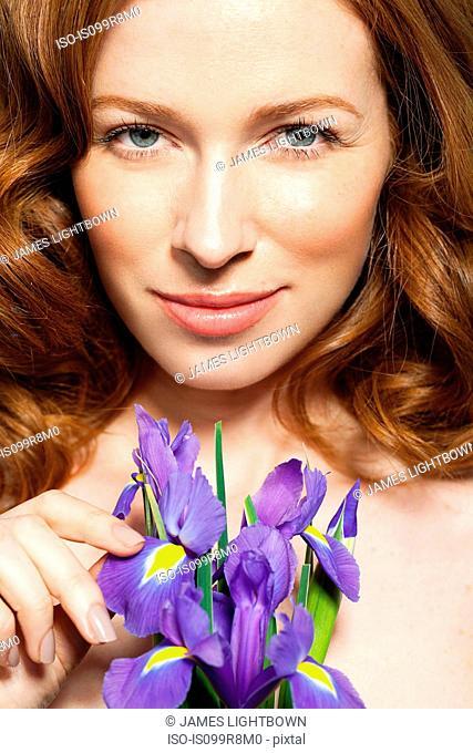 Woman holding purple flowers