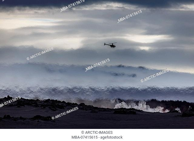 Helicopter flying over the volcano eruption at the Holuhruan Fissure, near the Bardarbunga Volcano, Iceland. August 29, 2014 a fissure eruption started in...