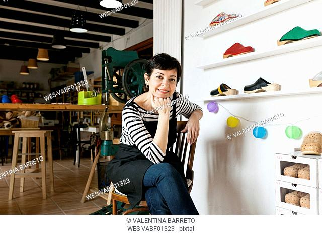 Portrait of confident clogmaker in her workshop
