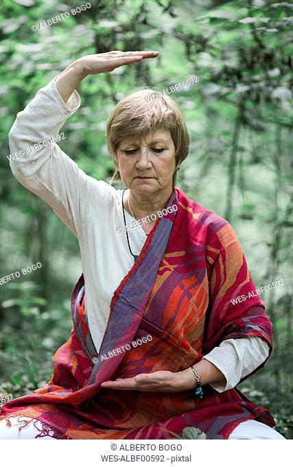 Senior woman doing yoga, meditating