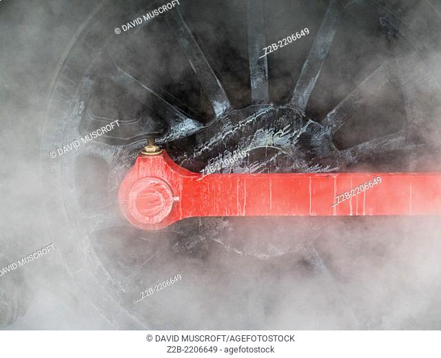 Detail of wheels on a vintage classic steam locomotive at Peak Rail Steam preservation, Matlock, Derbyshire, UK