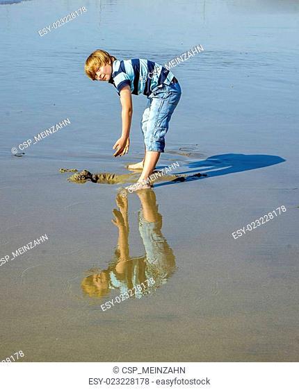 boy at the beach in Venice