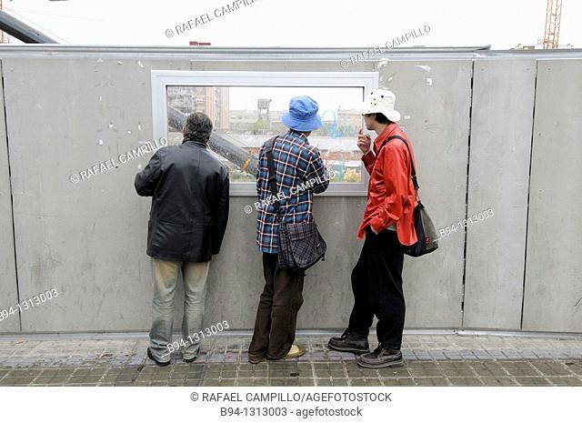 People looking at construction site, Plaça de les Glories, Barcelona, Catalonia, Spain