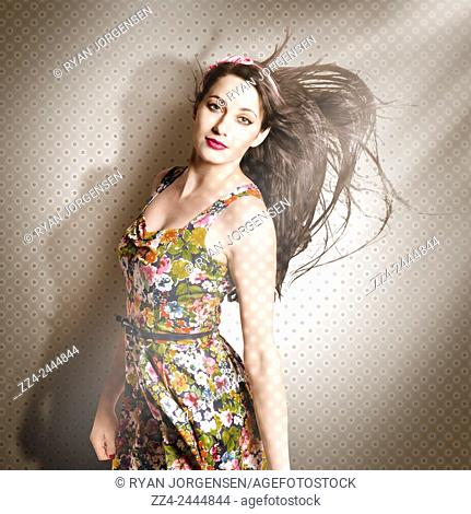 Unique fine art portrait of a beautiful brunette girl with long hair blowing in the throws of a hairdressing parlour. Beauty salon pinup