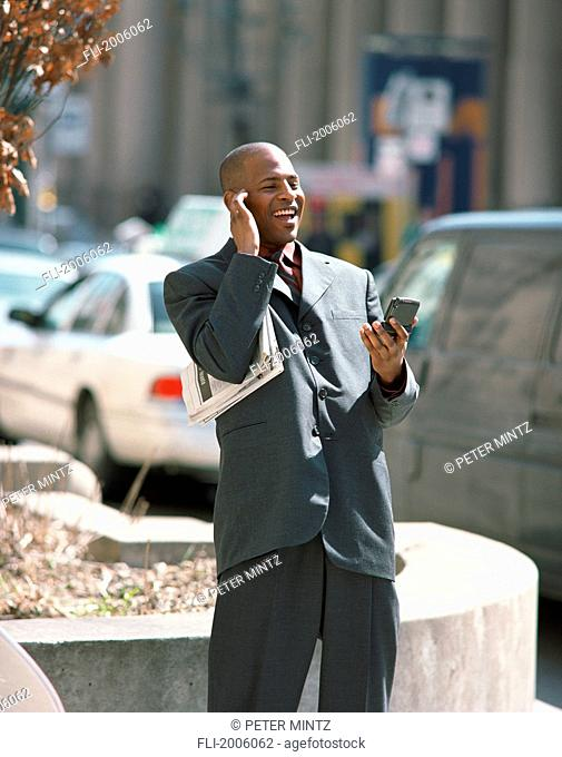 Fl6190, Peter Mintz; Businessman Holding Blackberry And Newspaper