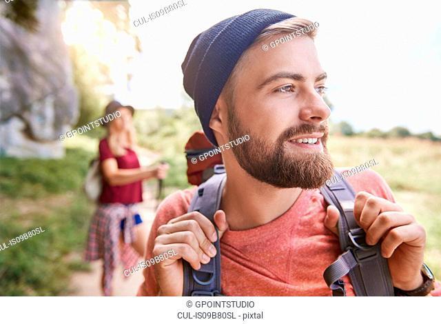 Portrait of man hiking looking away smiling, Krakow, Malopolskie, Poland, Europe
