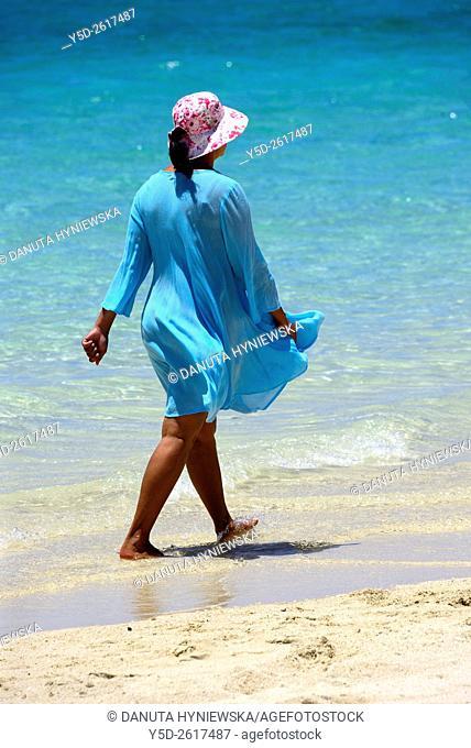 mature woman walking at the seaside, Pointe d'Esny beach, Grand Port District, Southeastern coast of Mauritius, Mascarene, Mascarene Islands, Mascarenhas