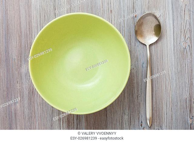top view of one green bowl and on gray brown table