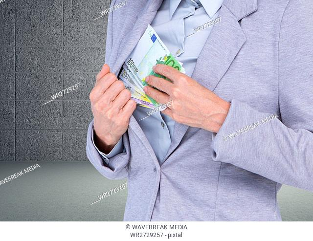 Digital composite image of a businessman keeping euro currency notes in inner pocket