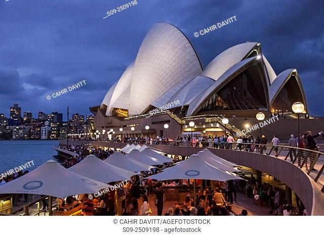 Bars, restaurants and night life at the Sydney Opera House at twilight, Bennelong Point, Sydney, New South Wales, Australia