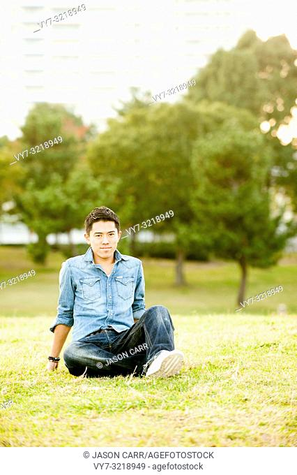 Asian male model poses for pictures in the cityscape